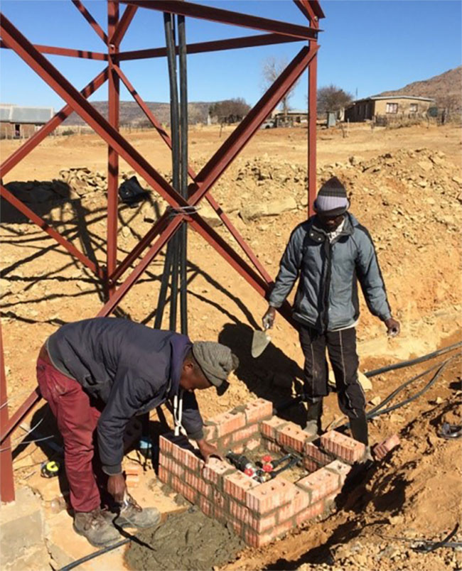 Local residents building valve chambers at Ha Moletsane village