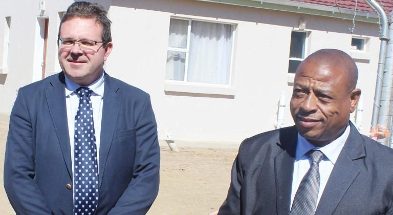 LSP Managing Director Andre Bothma and Health Minster Nyapane Kaya stand behind the clinic building
